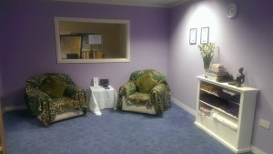 The calm and welcoming waiting area, with soft background music, aroma oils relaxing you and a range of holistic books to browse.